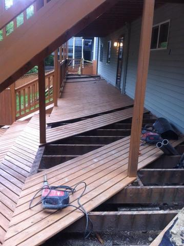 Removing the decking to access the foundation.