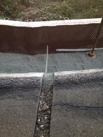 Delta drain barrier to re-route all water to base of wall.