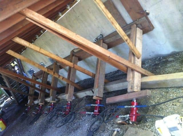Here are the hydraulic cylinders we used to push the wall back to level.
