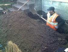 Removing soil.