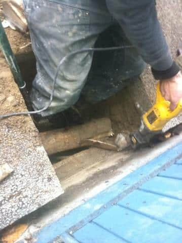 Tree root removal from footing.