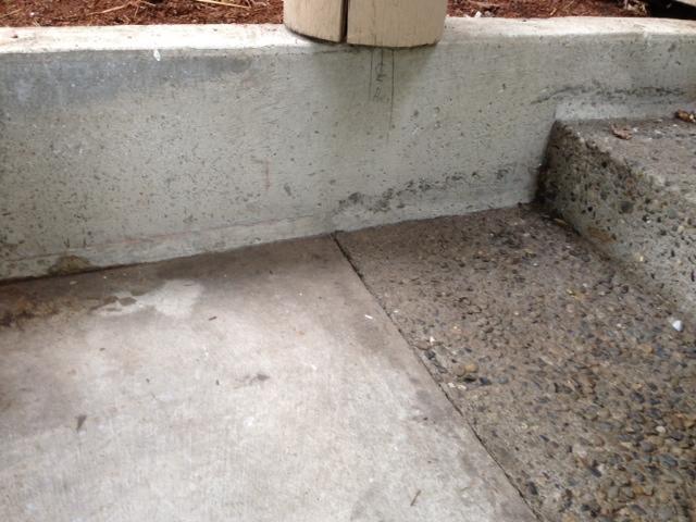 Sinking concrete driveway.