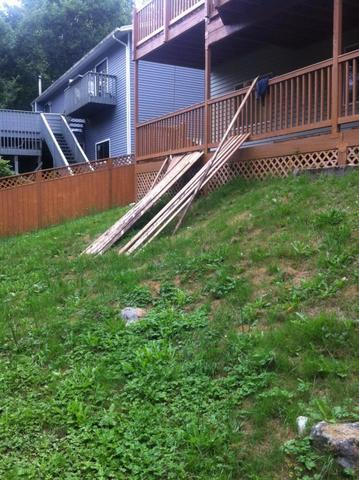 This is an image of the severe slope in this homes backyard.