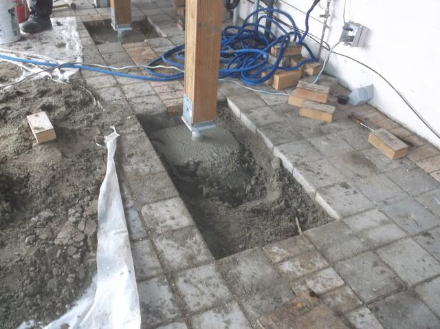We have filled in the footing for these deck supports.