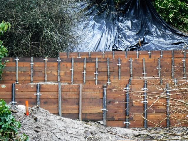 This photo is after several retaining walls were built to stabilize the hillside.
