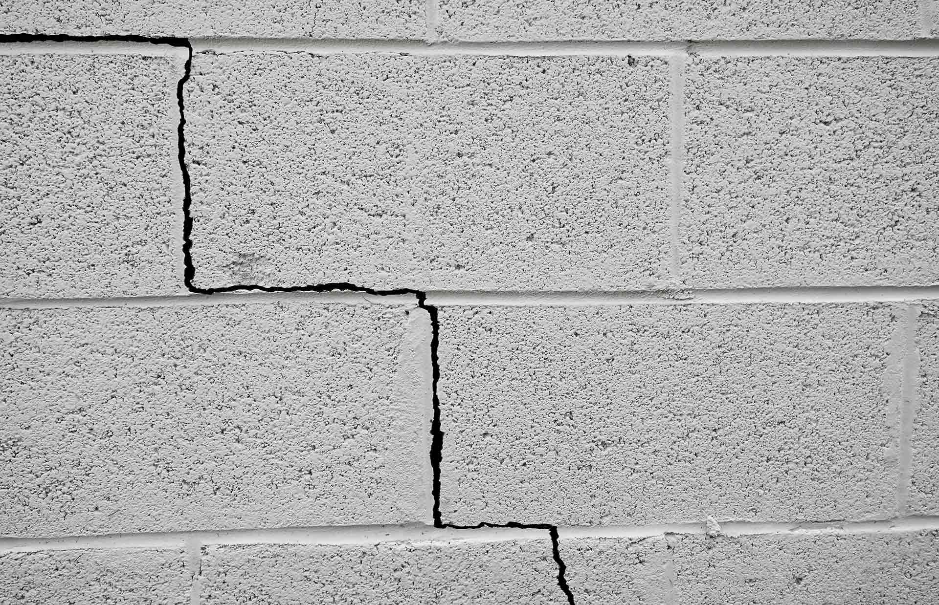 stair step cinderblock wall crack